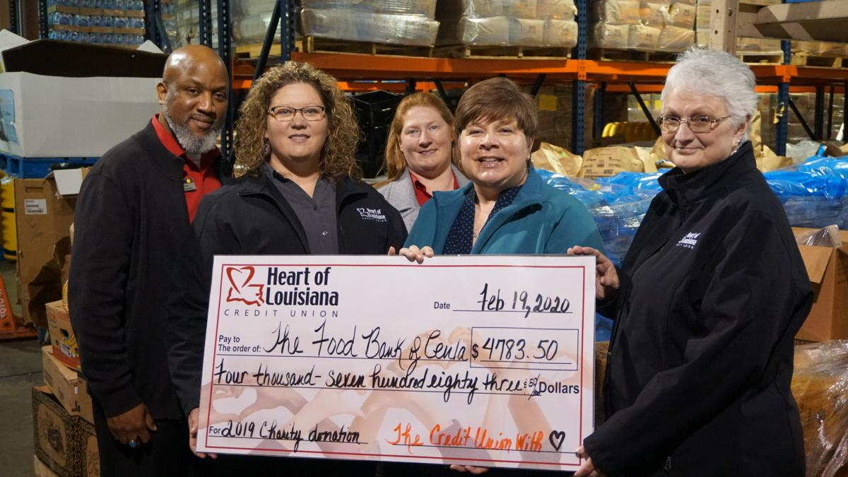 Heart employees Bruce Cotton, Desiree Gary, Stacey Leblanc and Sheila Hopkins present check to Jayne Wright Velez (center), The Food Bank of Central Louisiana's Executive Director
